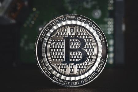 Gold metallic Bitcoins at electronic circuit motherboard.crypto currency mining.Digital money on blockchain network Standard-Bild - 118844643