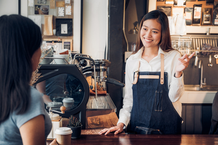 woman barista talking with customer about tasted of coffee cup with happy emotion at counter bar at cafe.coffee shop business owner concept,Service mind waiter Standard-Bild - 118844082