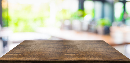 Empty perspective hard wood table and blurred garden cafe light background. product display template.Business presentation Standard-Bild - 118844657