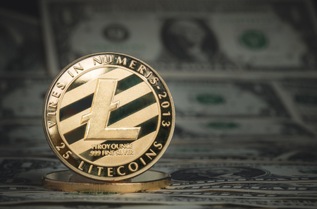 crypto currency gold litecoin on dollar banknote background.Virtual digital money concept.financial business. Standard-Bild - 118844665