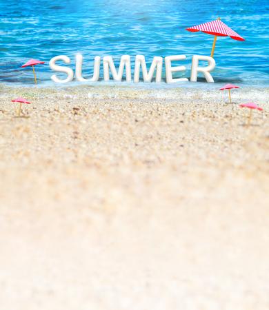 Summer (3D Rendering text) white word with beach umbrella on sand beach and blue sea blur background,Summer Vacation banner concept. Standard-Bild - 120919672