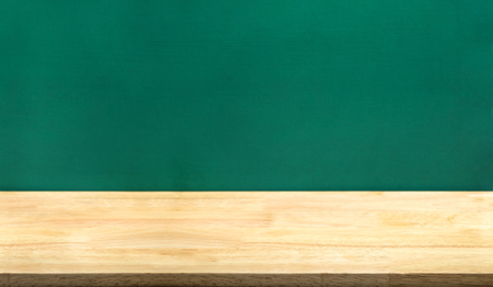 Empty wood table and green blackboard at background.education school concept product display template.Business presentation. Stockfoto