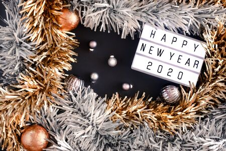 Happy new year lightbox on black table background.top view of tinsel,ball ,ornament party decorate on tabletop.holiday celebration greeting card Stock Photo