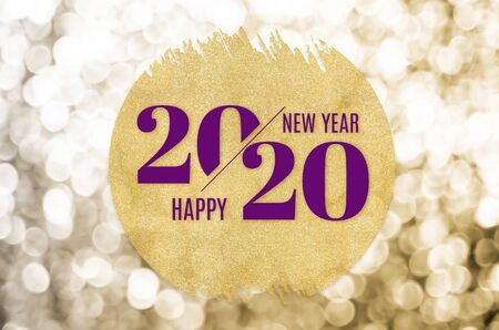 Happy new year 2020 word on gold circle glitter on gold bokeh sparkle background,minimal Holiday greeting card. Фото со стока