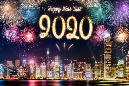 Happy new year 2020 firework over cityscape building near sea at night time celebration,mock up Banner for advertise on social media
