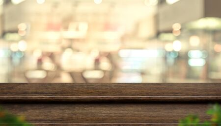 Empty step dark wood table top food stand with blur people in coffee shop background bokeh light. Mock up for display or montage of product, Banner for advertise on online media, business presentation Stok Fotoğraf