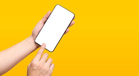 Hand touch mobile screen mockup on yellow background. Clipping path include all hand and mobile screen.connect technology concept