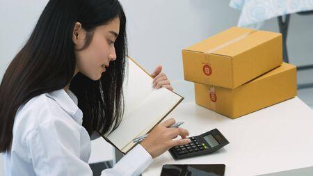 asian online shop seller packing box for sending to customer buy goods from online store.e-commerce for start up small business concept