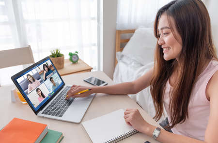 asian woman work from home with video conference app collaboration with colleagues.live streaming meeting.new normal lifestyle after covid-19 写真素材