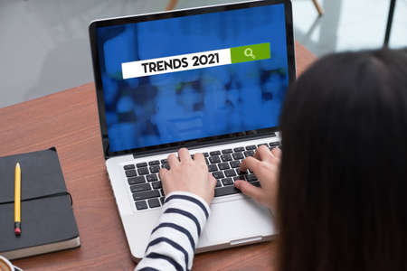 Trends for 2021 on laptop screen with woman type on laptop,Digital Business disruption or marketing trending.digital transformation