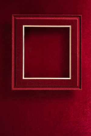 Blank Red Christmas felt photo frame on velvet red felt fabric  top view winter holiday background 写真素材