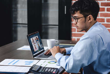 Work from home with asian businessman video conference collaboration with colleagues.live streaming meeting