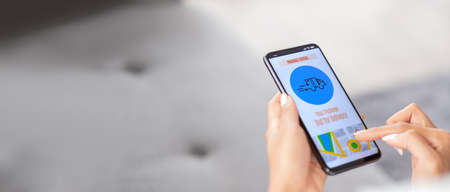 close up asian woman hand checking parcel delivery status on mobile post app at home.recieve goods delivery from online purchase store.online shopping omni channel post mail shipping concept