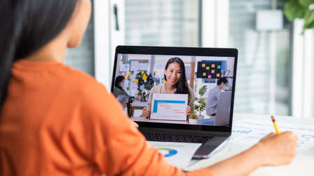 Video conference from home.asian woman teleconference collaboration with colleagues while present project timeline.live streaming meeting