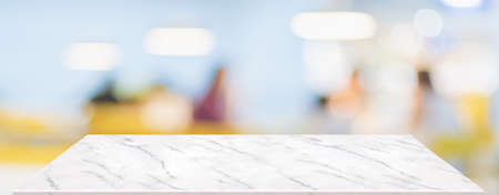 Perspective marble table with people in restaurant blur background.coffee shop with bokeh light,Mockup  banner for display of product
