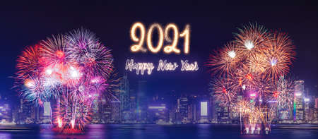 Happy new year 2021 firework over cityscape building near sea at night time celebration,mock up Banner for advertise on social media