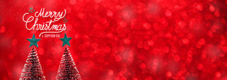 Merry christmas and happy new year text over xmas tree and green start on red glitter sparkling lights festive background.banner mockup for display of content for online advertise