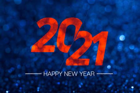 Happy new year 2021 with dark navy blue glitter bokeh light sparkling background,Holiday celebration festive greeting card