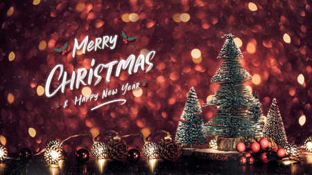 Merry Christmas and happy new year text over xmas tree on red glitter sparkling string lights festive bokeh background.holiday celebration greeting card