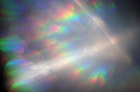 spectrum of the light in rainbow color and white cross