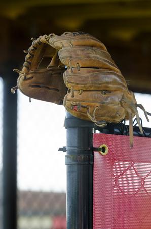 baseball mitt in dugout Stock Photo