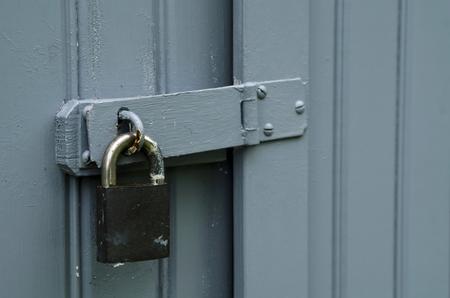 tresspass: Padlock on wooden door Stock Photo