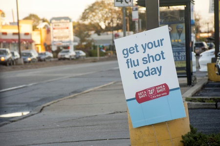 Street banner advertising where to get flu shots