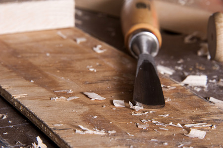 Wood carving chisel on workbench
