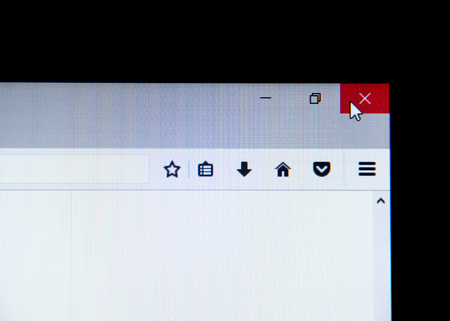 Red mouse cursor on red X on computer application