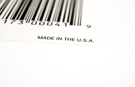 Bar code on white cardboard with Made in the U.S.A.