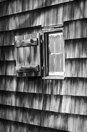 Black and white window on weathered rustic cabin