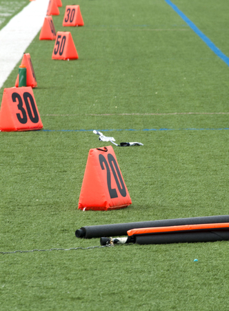 Orange Field Markers On Green Football Sideline 写真素材