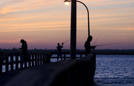 Evening Fisherman On Pier 写真素材