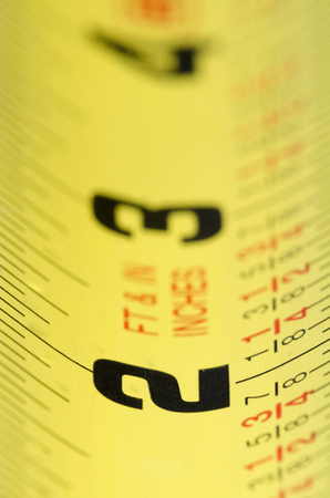 Macro shot of yellow measuring tape 写真素材