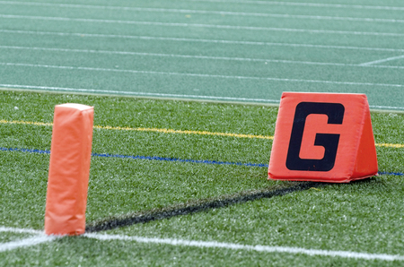 Orange Goal Marker And Pylon On Sideline