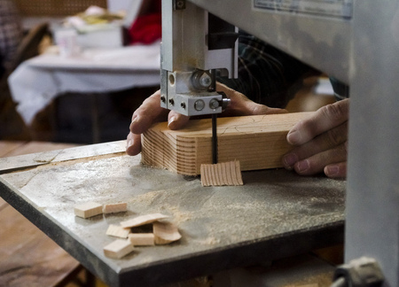 Woodworker's Hands Working On The Bandsaw