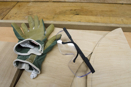 Work Gloves And Safety Glasses On Plywood Planks