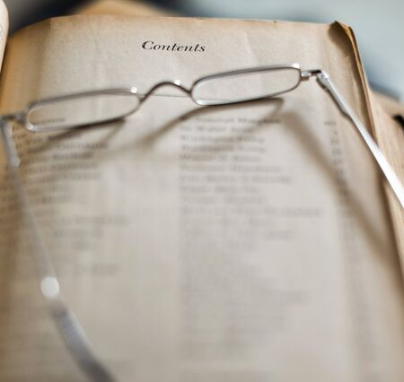 Old Book With Contents Table And Reading Glasses