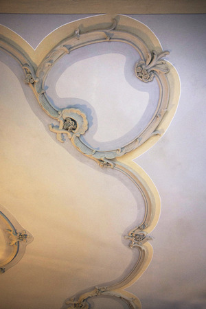 stucco facade: Stucco ornament. Ornamental background. Classicist architecture detail. Baroque ornamental ceiling. Wish background. Traditional building facade decoration. Restored antique wall.
