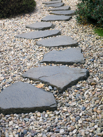 Path Of Plated Stones On The Gravel Bed In Japanese Garden. Meditative Stone  Walkway.
