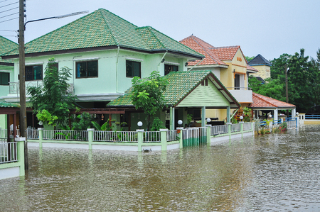 thailand flood: Lopburi, Thailand, October 17 2010: The heavy downpour caused a flash flood flooding into public houses.