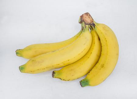 Ripe bananas, white background.