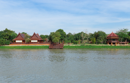 waterfront property: Houses along the river in Thailand