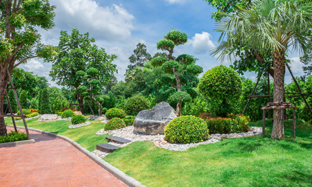 Natural flagstone path landscaping in home garden Stock Photo