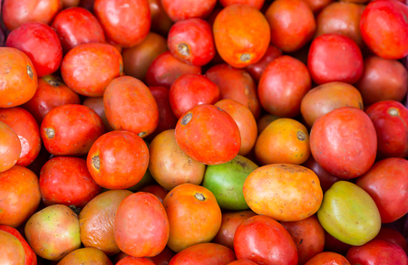 fresh red tomatoes in market Stock Photo