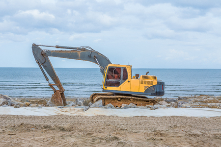 Thailand June 10.2016 excavators road repairs preparations for the beach in summer. Stock Photo