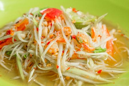 Spicy Green Papaya Salad a popular dish from the North Eastern part of Thailand,papaya salad thai style,Thai Green Papaya Salad Stock Photo