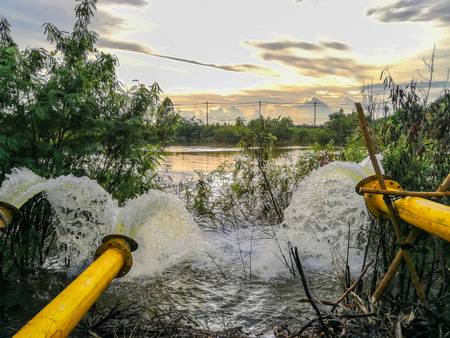 Waste water flow from water pipe into lake Stock Photo