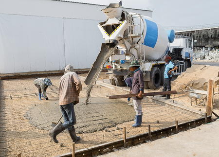 Bangkok, Thailand, and February 12, 2016.:Truck loads of concrete poured into the concrete at a construction site in Bangkok, Thailand.