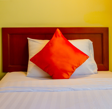 pillows on bed in modern bedroom design in hotel
